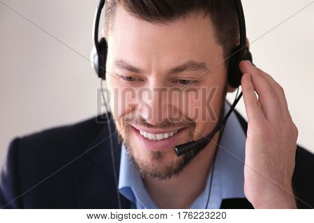 Young man with headset working in office