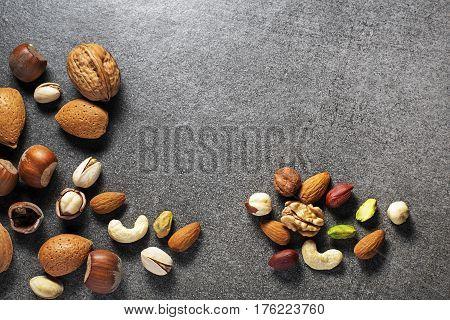 Almonds walnuts hazelnuts and pistachios on stone background