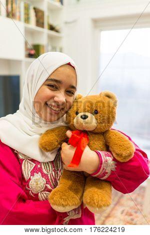 Arabic girl with Teddy bear