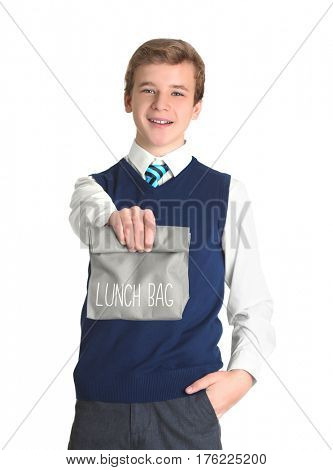 Cute schoolboy with lunch bag on white background