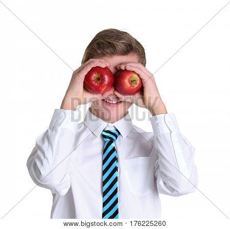 Cute schoolboy with apples on white background