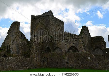 In the shadows of Cashel are the ruins of Hoare Abbey.