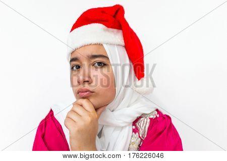 Muslim Arabian girl wearing santa hat
