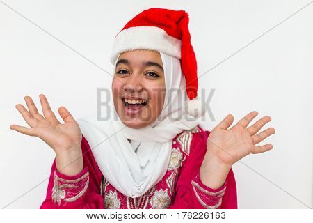 Muslim Arabian girl wearing santa hat