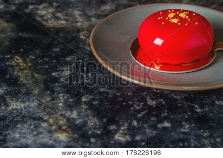 Trendy Mousse Cake With Mirror Glaze Decorated. Dark Background.
