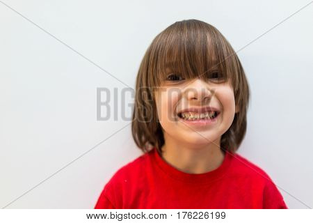 Cute little boy posing in studio