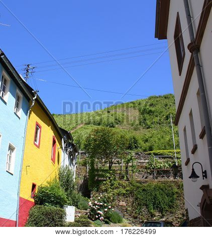 Colorful houses and view to vineyards of Zell on the Moselle. Germany