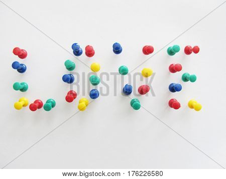 Love from clerical buttons on a white background, romance