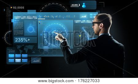 business, future technology, cyberspace and people - businessman in suit and glasses pointing finger to virtual screen projection over black background