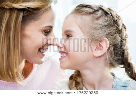 Close-up Portrait Of Happy Mother And Daughter Looking At Each Other