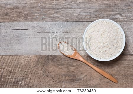 Rice In Spoon And Bowl. Jasmine Rice, Thai Rice, White Rice.