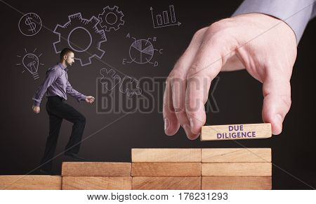 Business, Technology, Internet And Network Concept. Young Businessman Shows The Word: Due Diligence