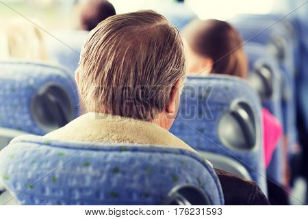 transport, tourism, road trip and people concept - close up of senior man sitting in travel bus