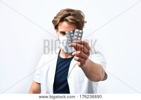 Bearded Caucasian Doctor Or Postgraduate Student With Pills In Mask