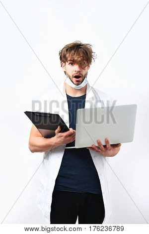 Bearded Caucasian Doctor Or Postgraduate Student With Laptop And Clipboard