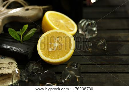 Healthy food and eating. Man cutting the lemons