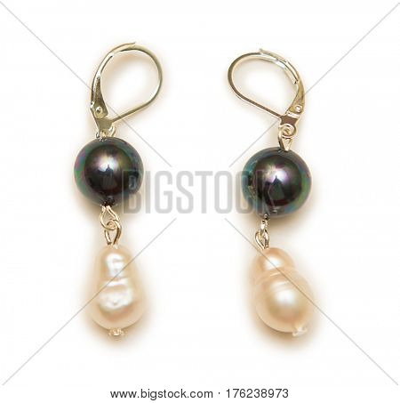 Elegant earrings isolated on white background