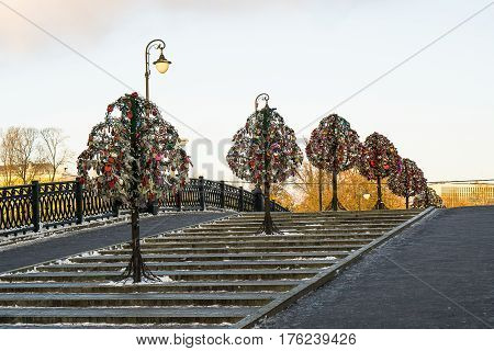 Decorative iron trees hung with locks on the Tretyakovsky pedestrian bridge in Moscow