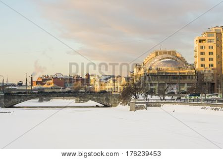 Moscow, Russia - January 30, 2017: Small stone bridge residential and administrative buildings on Yakimanka in Moscow
