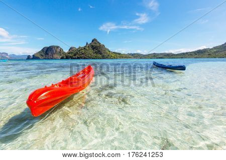 Kayak in the island lagoon between mountains. Kayaking journey in El Nido, Palawan, Philippines.