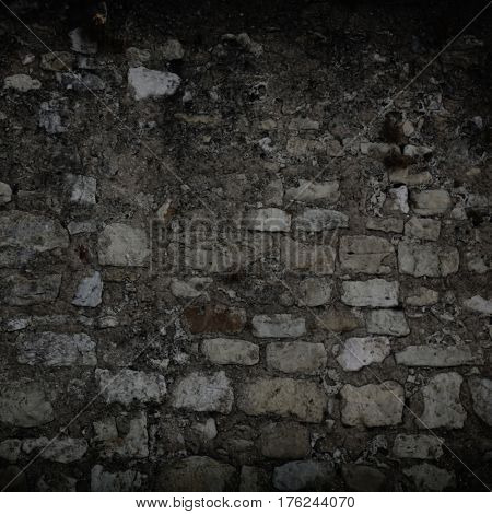 dark stone wall with vignette. decent background texture.