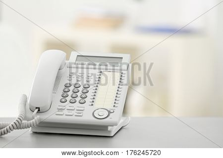 Telephone on table against blurred background