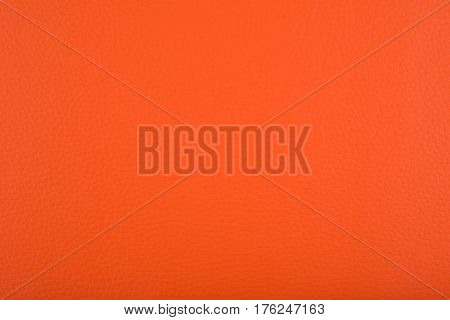 Orange leatherette material used as a background