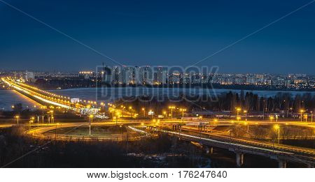 North Bridge and traffic roundabout in Voronezh, night cityscape aerial view from rooftop, long exposure