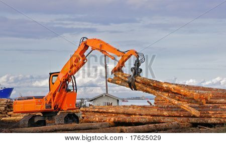 Heavy duty orange claw like logging machine for picking up and piling logs with river and ship in background