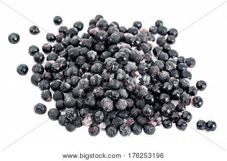 Organic frozen aronia berries on white background