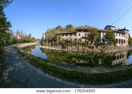 Country house along the Naviglio Grande of Turbigo (Milan Lombardy Italy) at fall. Fisheye
