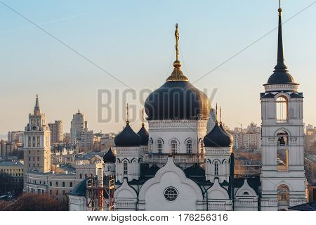 The Annunciation Cathedral in the center of Voronezh city, Russia, at background of South-East Railway Administration Building, sunset time