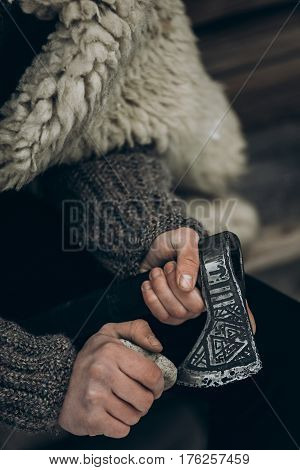 Northern Warrior With Weapon, Viking Sharpening His Axe Before Battle Hands Close-up, Scandinavian L