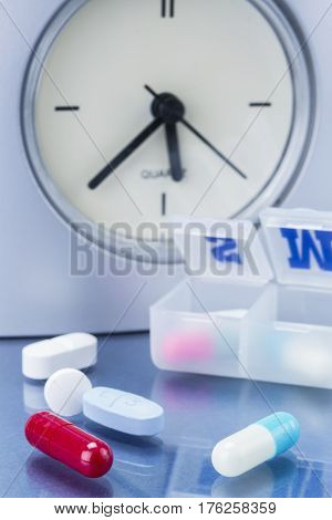 some pills in a pillbox daily medication treatment
