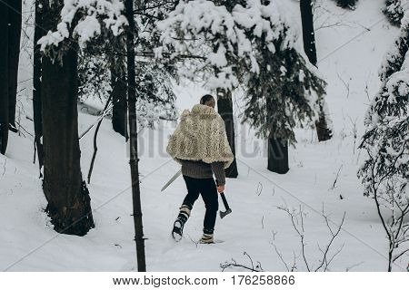 Viking Hunter Walking In Snow Winter Forest With Steel Axe And Sword, Viking Warrior Hunting In Scan