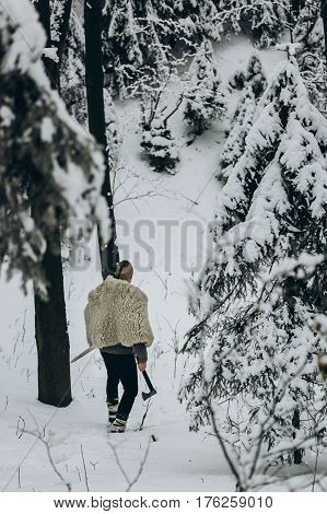Ancient Viking Hunter Walking In Snow Winter Forest With Steel Axe And Sword, Viking Warrior Hunting