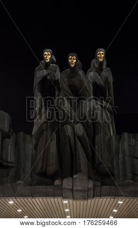 Vilnius Lithuania - january 09 2017: National Drama Theatre in Vilnius. Statues of Three Muses on Lithuanian National Drama Theatre at night. Three statues of Muses above entrance to Lithuanian National Drama Theatre on Gediminas street.