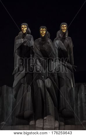 Vilnius Lithuania - january 08 2017: Statues of Three Muses on Lithuanian National Drama Theatre at night. National Drama Theatre in Vilnius on Gediminas Avenue. National Drama Theatre in Vilnius. Dramatic night background sets the mood.