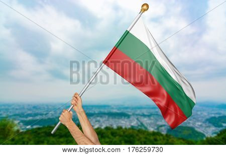 Young man's hands proudly waving the Bulgaria national flag in the sky, part 3D rendering