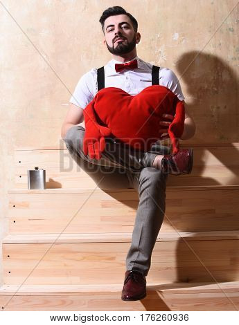 Bearded Man Sitting On Stairs With Serious Face