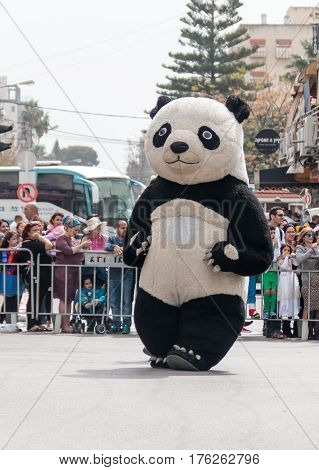 Participant In Carnival Dressed As Panda Goes Near The Viewers