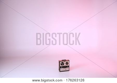 retro record player on floor on pink