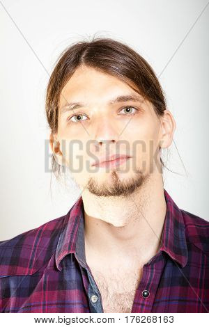 Masculinity concept. Man in plaid shirt. Young male posing on white background.