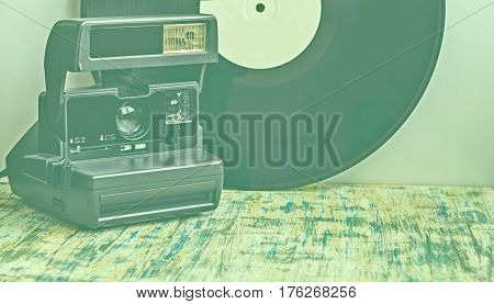 Greenish Background From The Camera Next To The Gramophone Record.