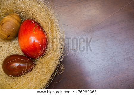 Easter eggs. three wooden eggs in the nest of sisal. Easter decorating idea for home. Closeup. natural materials