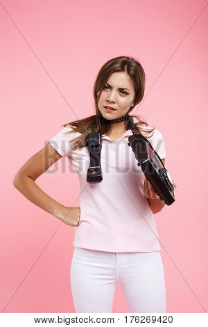 Tired of phonecall woman holding landline phone and telephone cord around neck looking with anger
