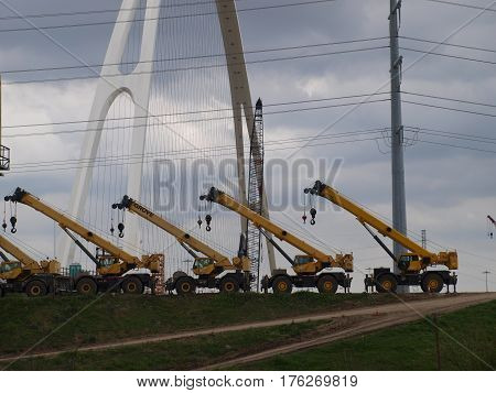 Dallas,USA,March 11,2014. Cranes lined up with the second span of the Margaret McDermott bridge cable stays in place seem to show the end of construction is nearing. The Horseshoe Project at the old Mixmaster is nearing completion as well.