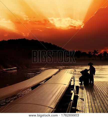Taxi boats that use in Thailand on Khwae Yai river. Mooring at sunset