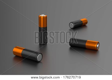 A few AA or AAA batteries on gray background