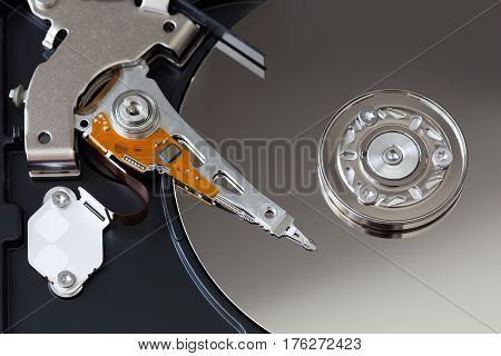 Open hard disk of a computer close-up